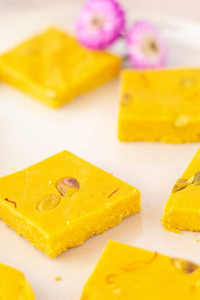 barfi squares close up on a plate