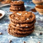 chocolate olive oil cookies stacked onto of each other in a pile