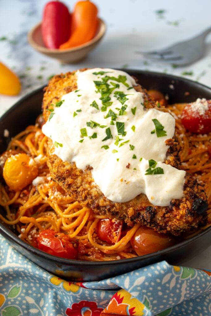 Air Fryer Spicy Chicken Parmesan on a bowl of pasta