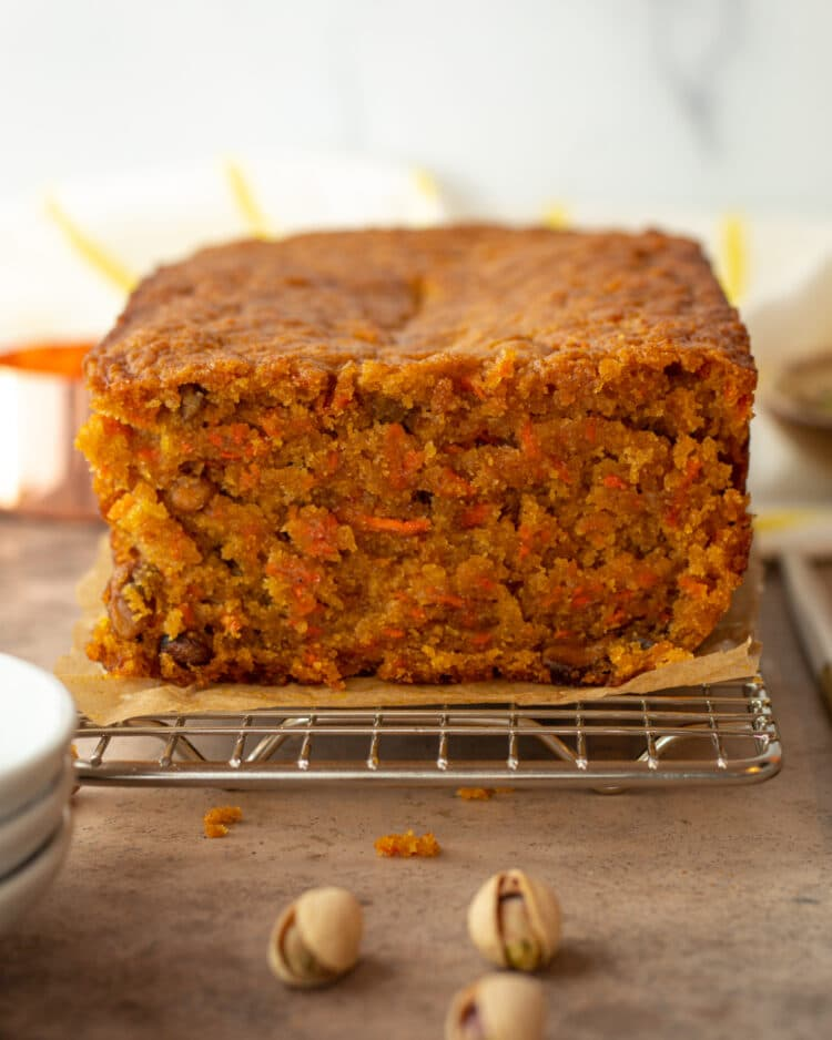 whole loaf of carrot and cardamom cake cut through