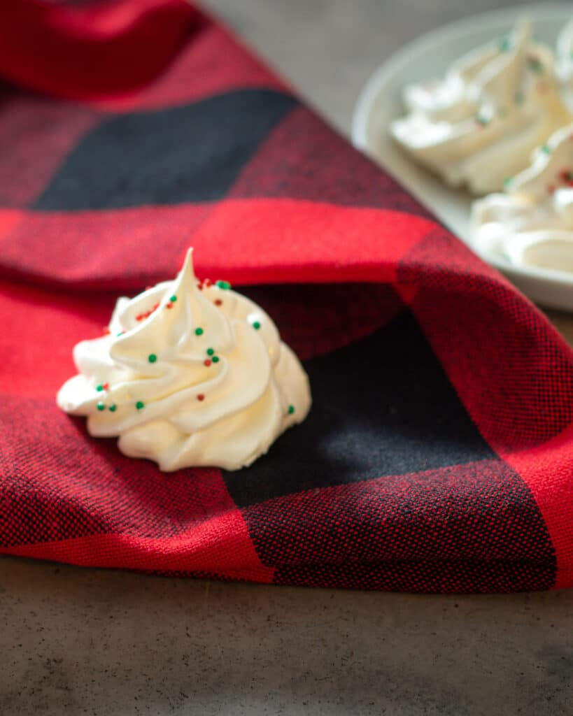 solo meringues on a red and black gingham napkin