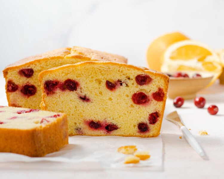 cranberry orange pound cake loaf with slices of cake